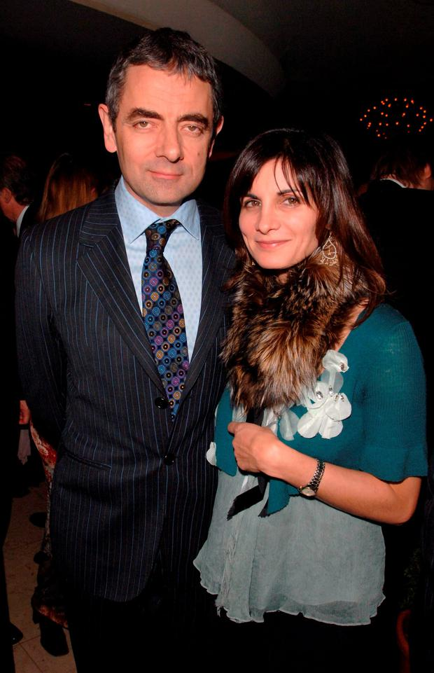 Rowan Atkinson and his wife Sunetra Sastry who has been granted a divorce on the grounds