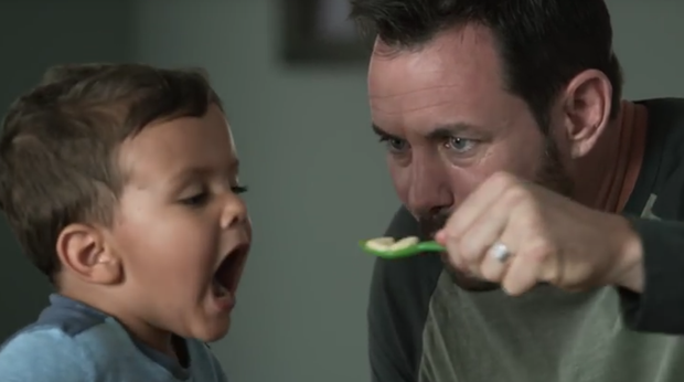 The ad shows two loving fathers feeding their son soup Credit: Campbell's