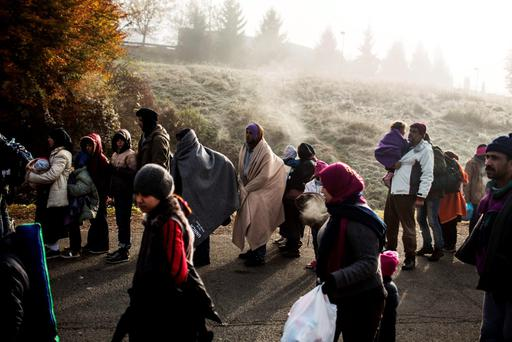 Afghan migrants wait to to enter the registration camp after their arrival by train from the Croatian border, in Sentilj, Slovenia