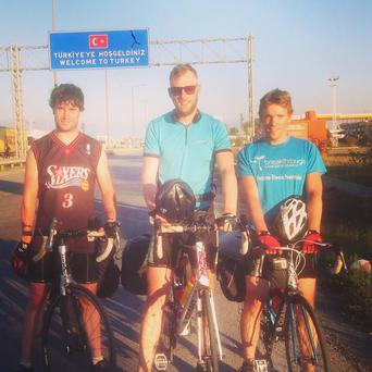 The three cyclist on arrival of their 16th and final country Turkey