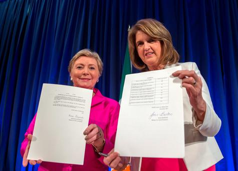 Tainaiste Joan Burton and Minister Frances Fitzgerald sign the commencement order for the Marriage Act 2015, which will enable same-sex couples to marry in Ireland , at Dublin Castle. Photo: Arthur Carron