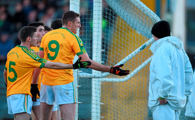 South Kerry's Padraig O'Sullivan, 5, and Brendan O'Sullivan appeal to the umpire over a disputed Legion point in the Kerry county final