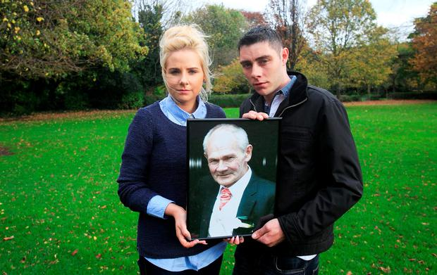 Maggie Bonner and her boyfriend Michael Jackson from Mayo with a photo of Maggie's father Frankie Bonner. Photo: Gareth Chaney