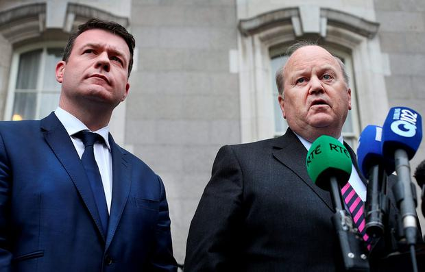 Environment Minister Alan Kelly and Finance Minister Michael Noonan speaking to the media at Leinster House yesterday. Photo: Steve Humphreys