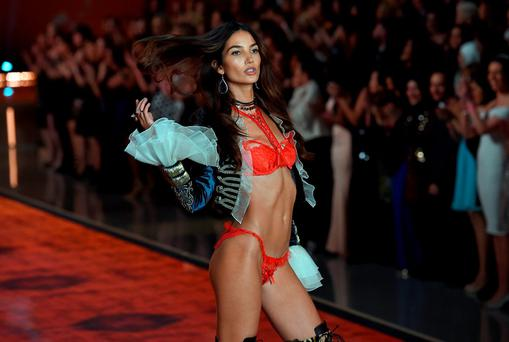 Model Lily Aldridge presents a creation during the 2015 Victoria's Secret Fashion Show in New York