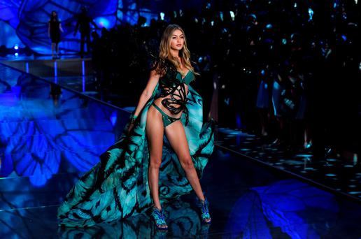 Model Gigi Hadid presents a creation during the 2015 Victoria's Secret Fashion Show