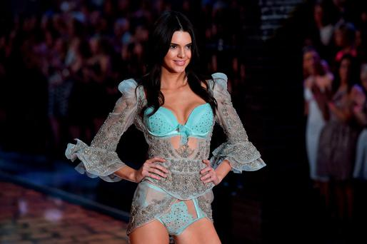 Model Kendall Jenner presents a creation during the 2015 Victoria's Secret Fashion Show