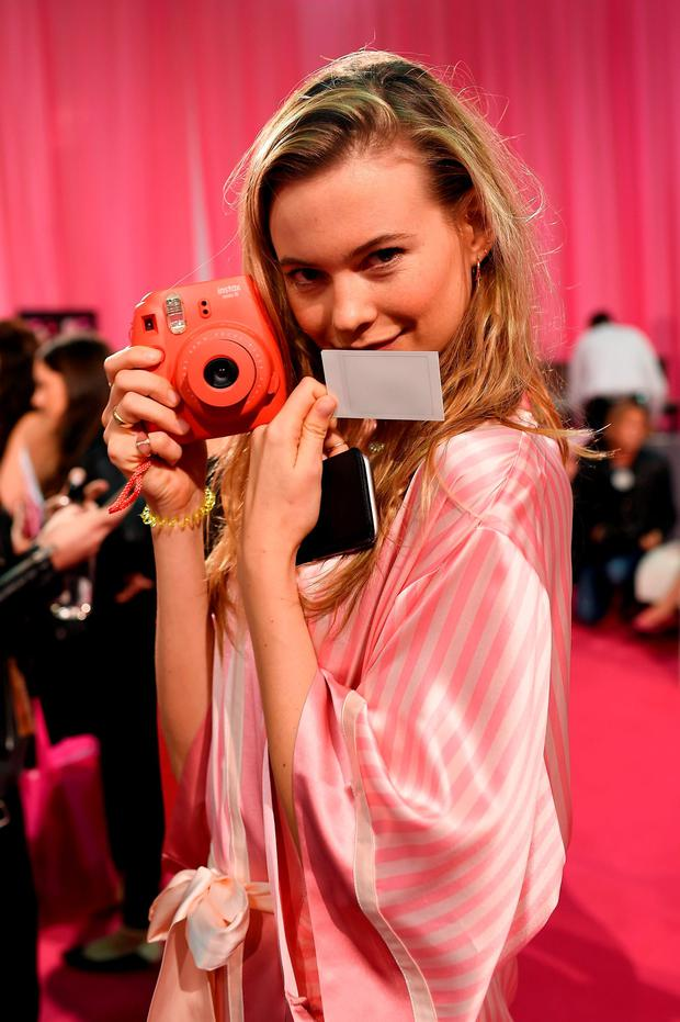 Behati Prinsloo is seen backstage before the 2015 Victoria's Secret Fashion Show at Lexington Avenue Armory on November 10, 2015 in New York City. (Photo by Dimitrios Kambouris/Getty Images for Victoria's Secret)