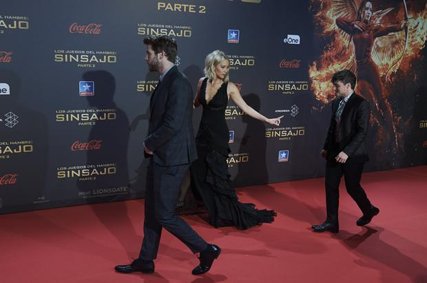 MADRID, SPAIN - NOVEMBER 10: (L-R) Actors Liam Hemsworth, Jennifer Lawrence and Josh Hutcherson attend