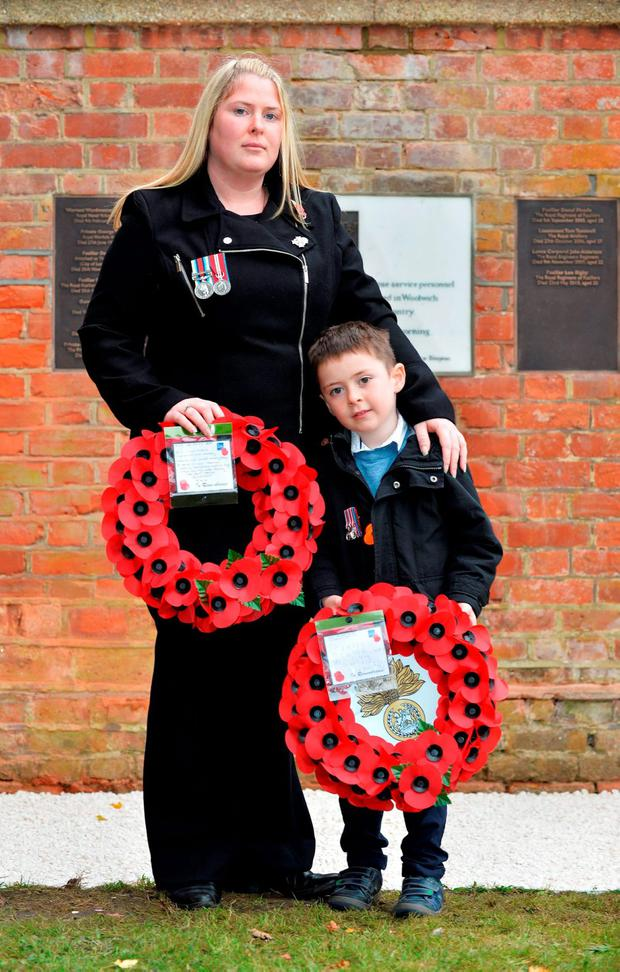 Handout photo issued by the MoD of Rebecca Rigby, the widow of murdered Fusilier Lee Rigby, and son Jack as they attend a service at St George's Chapel in Woolwich, to mark Armistice Day, the anniversary of the end of the First World War