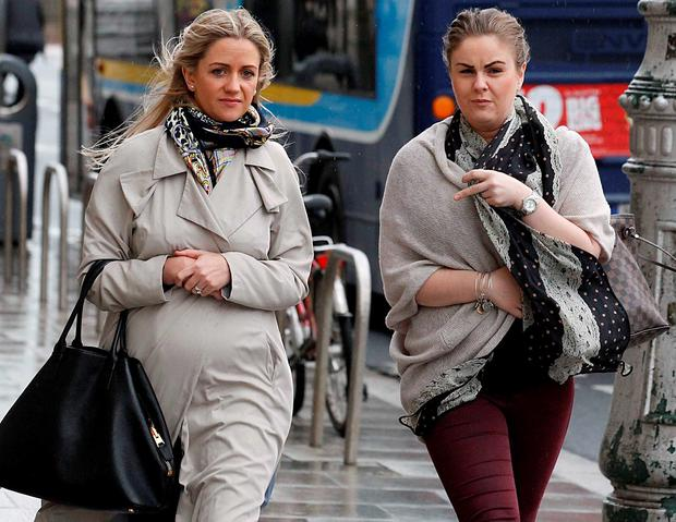 Cassandra Reddin (left ) and Aine Maher leaving the Four Courts. Photo: Collins Courts