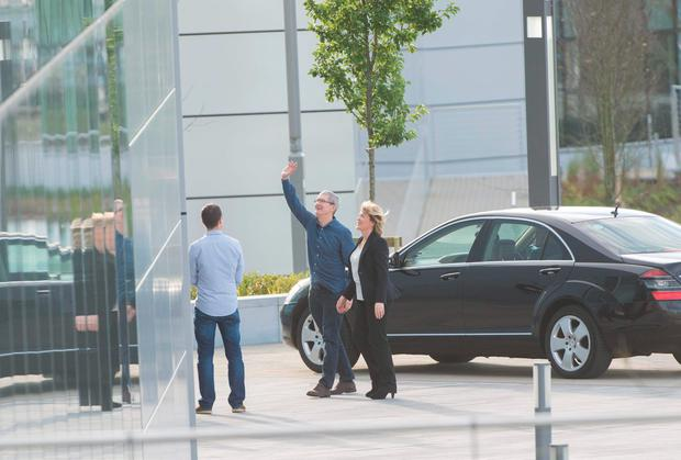 Tim Cook is welcomed by Cathy Kearney, head of Apple Operations Europe, at Apple's European HQ in Hollyhill, Cork
