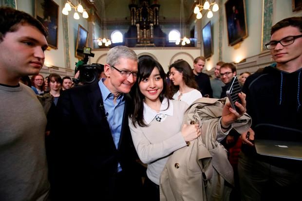 Tim Cook joins students for selfies during a visit to Trinity College yesterday