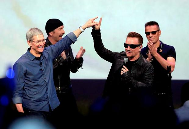 Apple CEO Tim Cook with U2