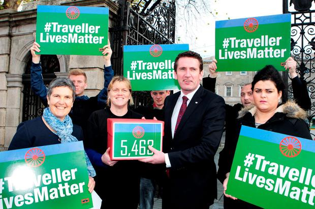 Tessa Collins and other Travelling community members hand the petition to Aodhán Ó Riordáin