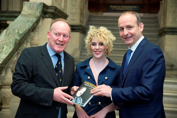Conor Lenihan with his niece Claire Lenihan and Fianna Fáil leader Micheál Martin at the launch of his new book, 'Haughey: Prince of Power'