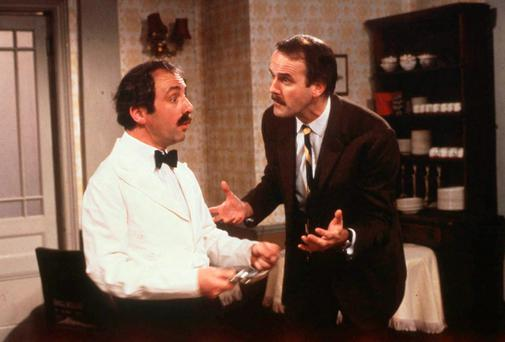 Andrew Sachs and John Cleese as waiter Manuel and hotel owner Basil Fawlty in classic sitcom Fawlty Towers