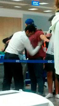 A passenger is searched by a security guard at Sharm el-Sheikh airport in Egypt