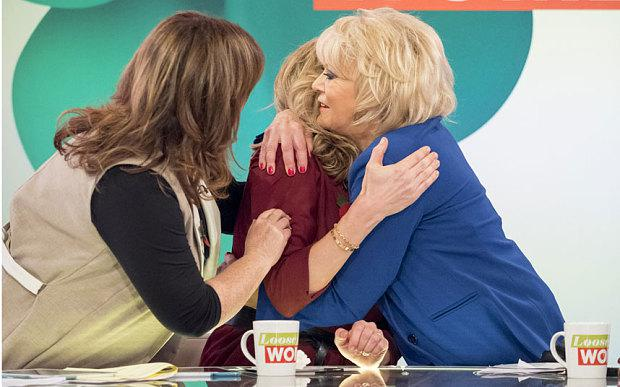 Penny Lancaster is comforted by Coleen Nolan and Sherrie Hewson
