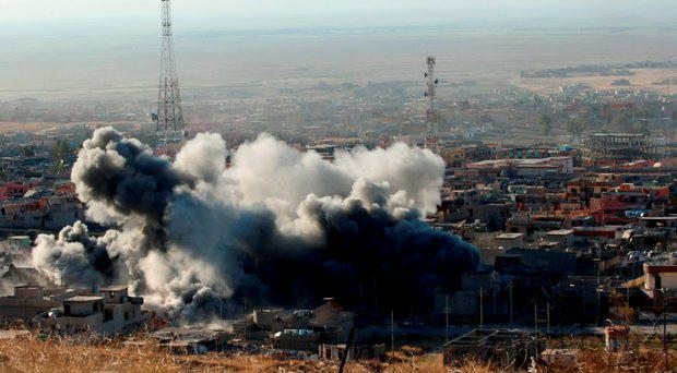 Smoke rises from the site of U.S.-led air strikes in the town of Sinjar, November 12, 2015