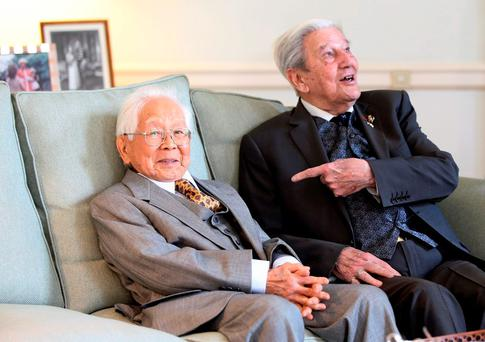 British WWII veteran Roy Welland, right, and Japanese Kohima/Imphal veteran Mikio Kinoshita, left, during a reconciliation reception at British Embassy in Tokyo Thursday, Nov. 12, 2015