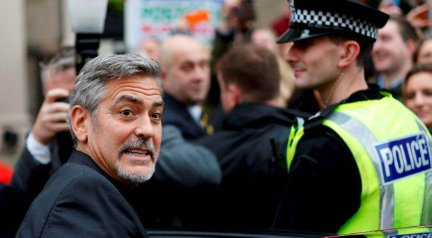 Hollywood actor George Clooney leaves the Post Code lottery Offices in Edinburgh,Scotland. November 12, 2015