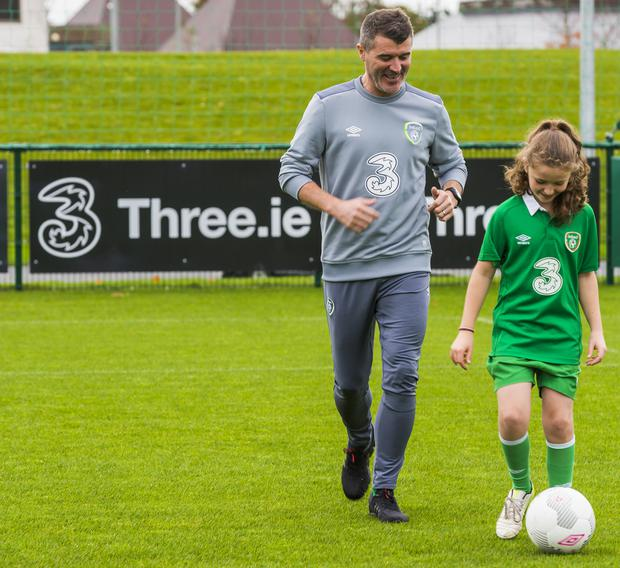 Roy Keane in training with Ruby Davis (9) at Three's announcement today of the renewal of its partnership with the Republic of Ireland football team and all international squads, pledging support to Irish football until 2020 in a deal worth €8.9 million.