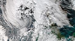 Handout satellite image issued by the University of Dundee, taken at 12:45pm today, showing Storm Abigaill which is set to sweep across Ireland. Photo: University of Dundee/NEODAAS/PA Wire