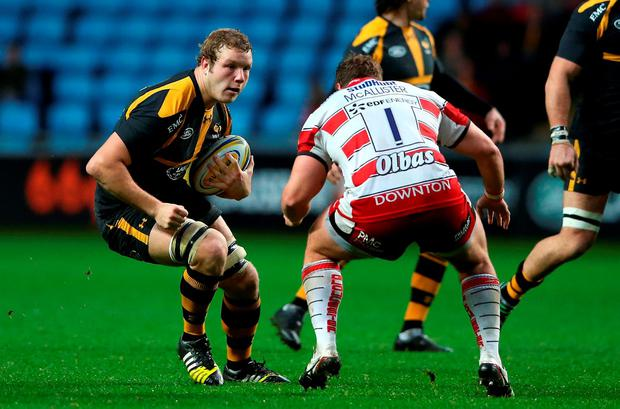 Joe Launchbury of Wasps takes on Paddy McAllister during the Aviva Premiership match between Wasps and Gloucester at The Ricoh Arena