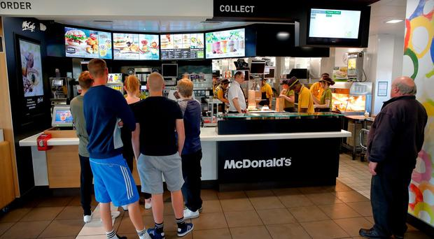 Customers queue to order food inside a McDonald's restaurant in Manchester. Photo: Bloomberg