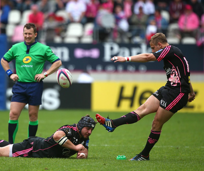 Jules Plisson of Stade Francais kicks a penalty