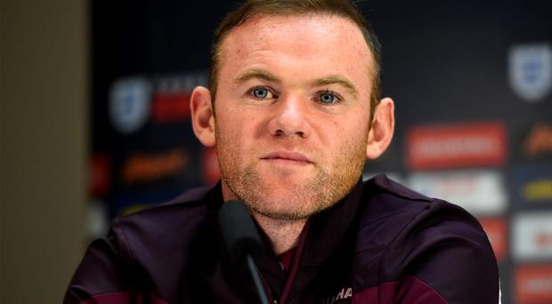England captain Wayne Rooney faces the media during an England press conference in Alicante yesterday