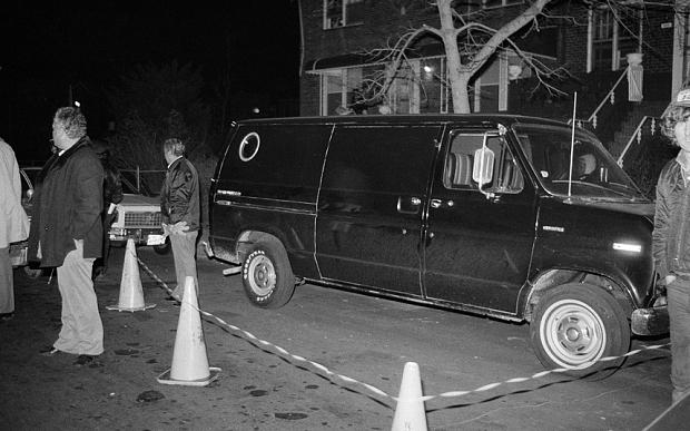In this Dec. 13, 1978 file photo, police cordon off an area around a stolen black van discovered in the Brooklyn borough of New York. Police suspect the van was used by thieves who escaped with more than $6 million in cash and jewels from a John F. Kennedy International Airport hangar
