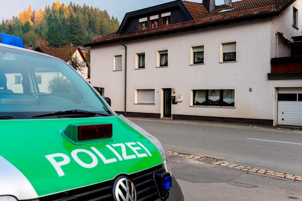 A police car stands in front of a house in Wallenfels, southern Germany, Friday morning, Nov. 13, 2015 where police found bodies of multiple babies