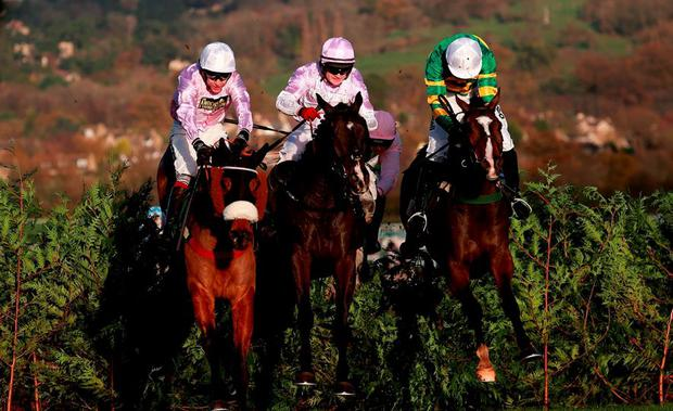 Eventual winner Josies Orders ridden by Nina Carberry (right) jumps the last with Bless The Wings ridden by Kevin Sexton (centre) and Any Currency ridden by Aidan Coleman in the Glenfarclas Cross Country Handicap Chase during day one of The Open at Cheltenham. David Davies/PA Wire.