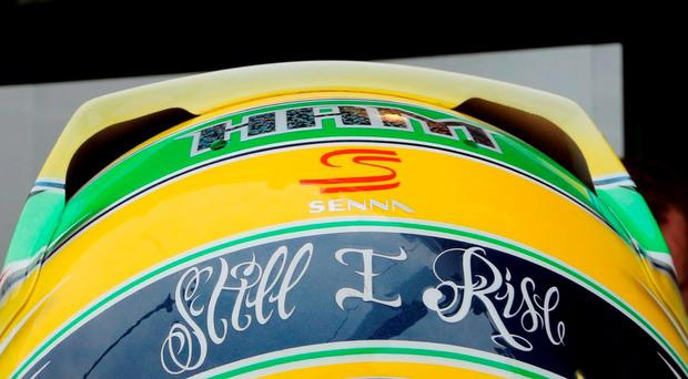 The helmet of Mercedes Formula One driver Lewis Hamilton of Britain is seen painted with