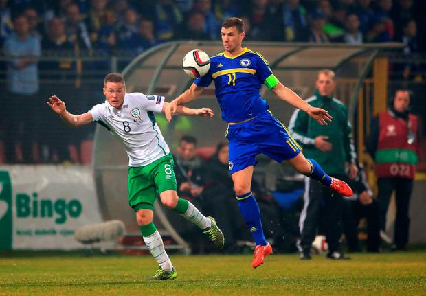 Bosnia and Herzegovina's Edin Dzeko (right) and Republic of Ireland's James McCarthy battle for the ball during the UEFA Euro 2016 Qualifying Playoff first leg at The Stadion Bilino Polje, Zenica. PRESS ASSOCIATION Photo. Picture date: Friday November 13, 2015. See PA story SOCCER Bosnia. Photo credit should read: Nick Potts/PA Wire. RESTRICTIONS: Editorial use only, No commercial use without prior permission, please contact PA Images for further information: Tel: +44 (0) 115 8447447.