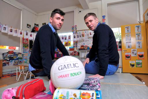 Colleagues Jamie O'Sullivan of Legion, Killarney and Tomás Ó Sé of Nemo Rangers, who will go head to head in the Munster Club football semi-final, pictured at Gaelscoil de hÍde in Fermoy