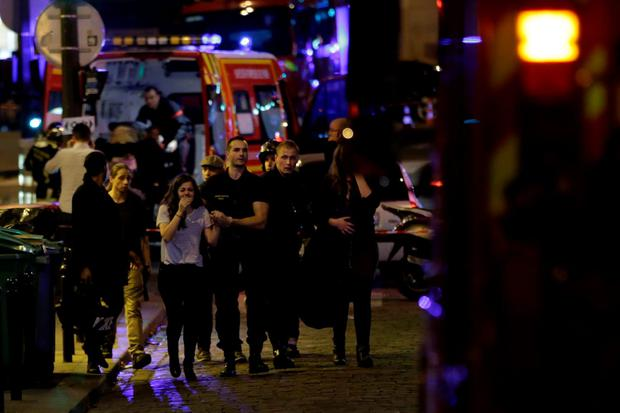 People are evacuated following an attack at the Bataclan concert venue in Paris. Photo: AFP/Getty Images