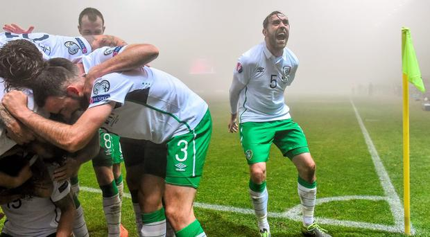 Richard Keogh celebrates after team-mate Robbie Brady scored in the second half.