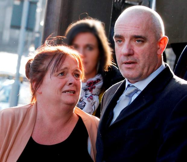 Antoinette McLoughlin and her husband Michael at the court