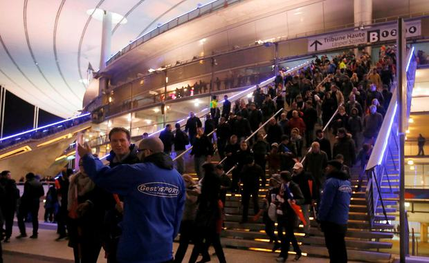 Crowds leave the Stade de France where explosions were reported to have detonated outside the stadium during the France vs German friendly match near Paris, November 13, 2015. REUTERS/Gonazlo Fuentes