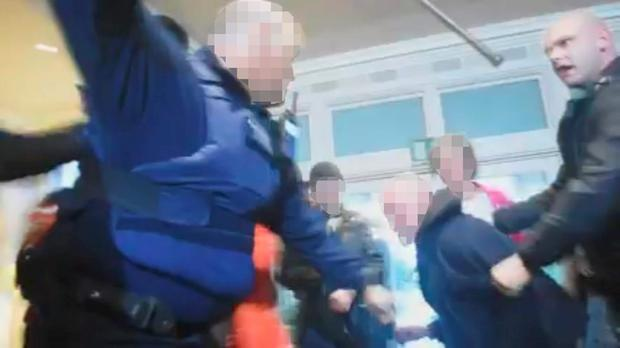 Still pictures from the mobile phone video posted on social media show a garda using his baton