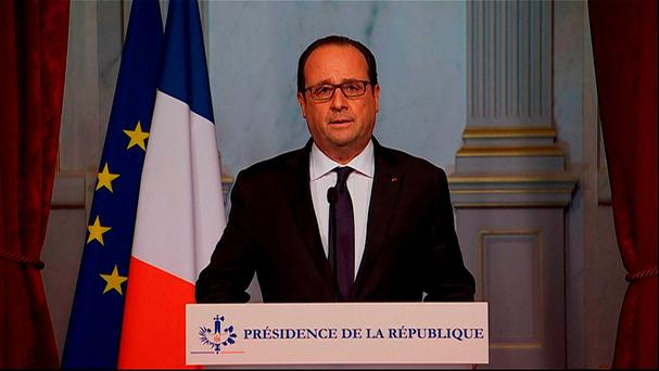 French president Francois Hollande addresses the nation after the attacks occurred across Paris. Photo: AFP/Getty Images