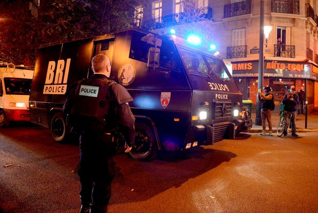 PARIS, FRANCE - NOVEMBER 13: Policemen patrol the streets during gunfire near the Bataclan concert hall on November 13, 2015 in Paris, France. Gunfire and explosions in multiple locations erupted in the French capital with early casualty reports indicating at least 60 dead. (Photo by Antoine Antoniol/Getty Images)