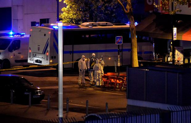Forensic experts inspect the site of an attack, a restaurant outside the Stade de France stadium in Saint-Denis, north of Paris, early on November 14, 2015, after a series of gun attacks occurred across Paris as well as explosions outside the national stadium where France was hosting Germany. A number of people were killed and others injured in a series of gun attacks across Paris, as well as explosions outside the national stadium where France was hosting Germany. AFP PHOTO / FRANCK FIFEFRANCK FIFE/AFP/Getty Images