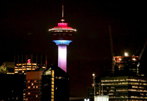The Calgary Tower was lit up with the colors of the French flag to show support and sympathy regarding the Paris attacks in Calgary, Alberta on Friday, Nov. 13, 2015. (Larry MacDougal/The Canadian Press via AP)
