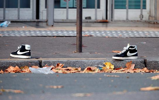 A pair of abandoned shoes seen left in the street near the Bataclan concert hall the morning after a series of deadly attacks in Paris, November 14, 2015. REUTERS/Charles Platiau