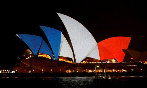 The blue, white and red colours of France's national flag are projected onto the sails of Sydney's Opera House in Australia November 14, 2015 following the attacks in Paris. REUTERS/Jason Reed