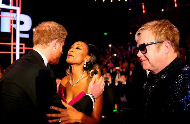 Britain's Prince Harry kisses Beverley Knight as Elton John looks on, after the Royal Variety Performance at the Albert Hall in London, November 13, 2015. REUTERS/Paul Hackett